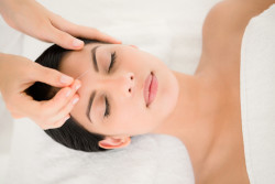 Woman in a facial acupuncture therapy at the health spa